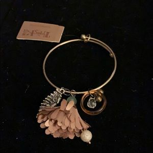 Gold bracelet with charms by Treksa